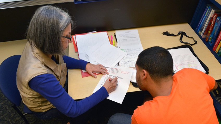 An advisor works on a paper with a student