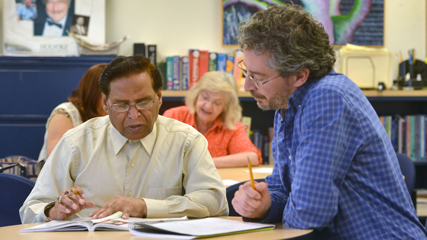 A tutor working with an adult student
