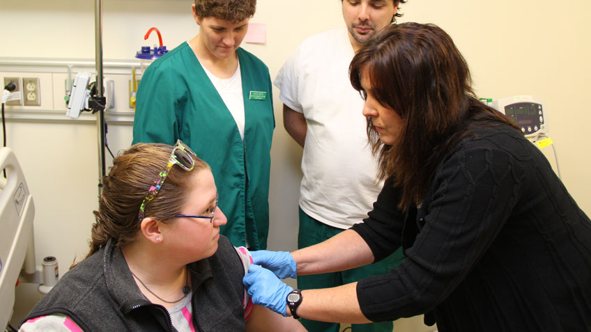 A student receiving a vaccination