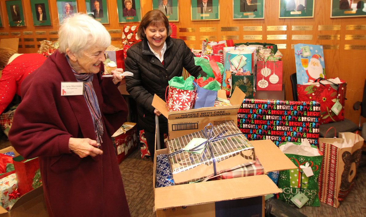 Sister Jane Morrissey, of Homework House, gets an eyeful of gifts at the 18th annual Giving Tree campaign closing ceremony.