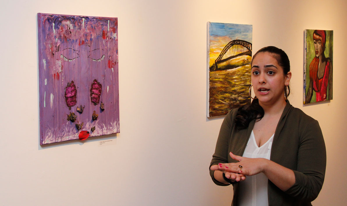"Alicia Shibley, '13, talks about the HCC Taber Art Gallery exhibit ""Impressions of Home."""