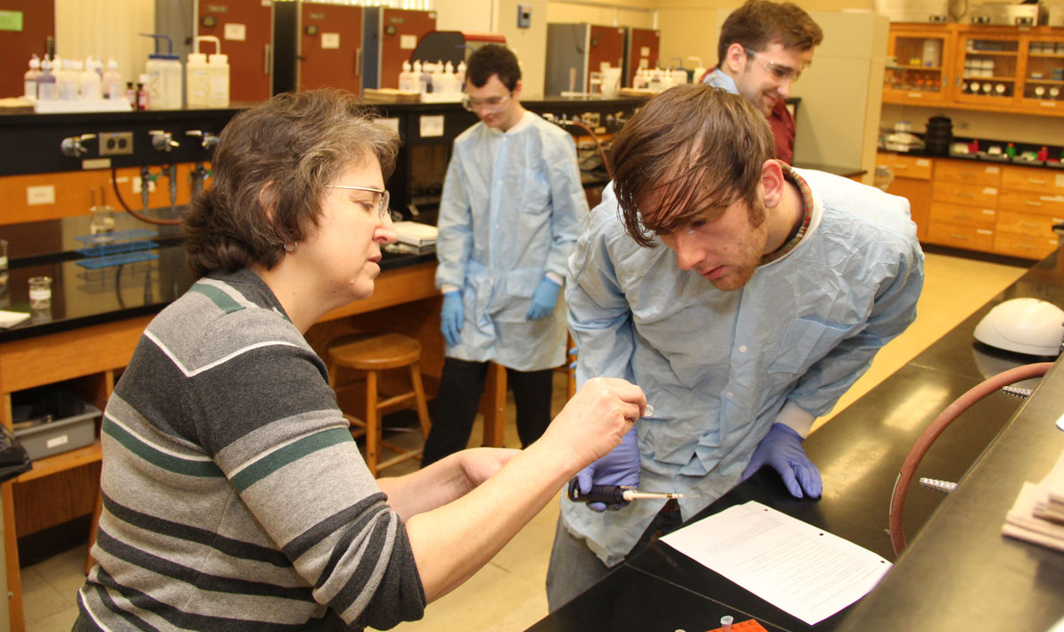 Honors biology professor Carolyn Wetzel with student Aaron Collette of Chicopee.