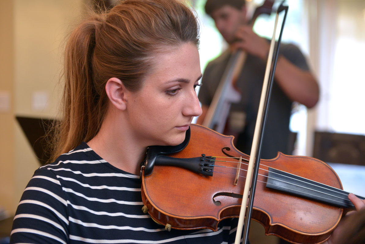 Katie Dubchak plays violin.