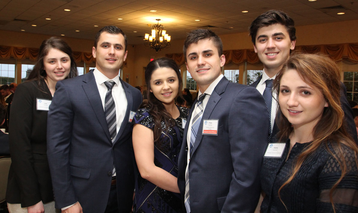 Lisa, Roman, Eva, Filipp, David and Katie Dubchak attend the Grinspoon Entrepreneurship Initiative Award Ceremony & Banquet at the Log Cabin in Holyoke in April.