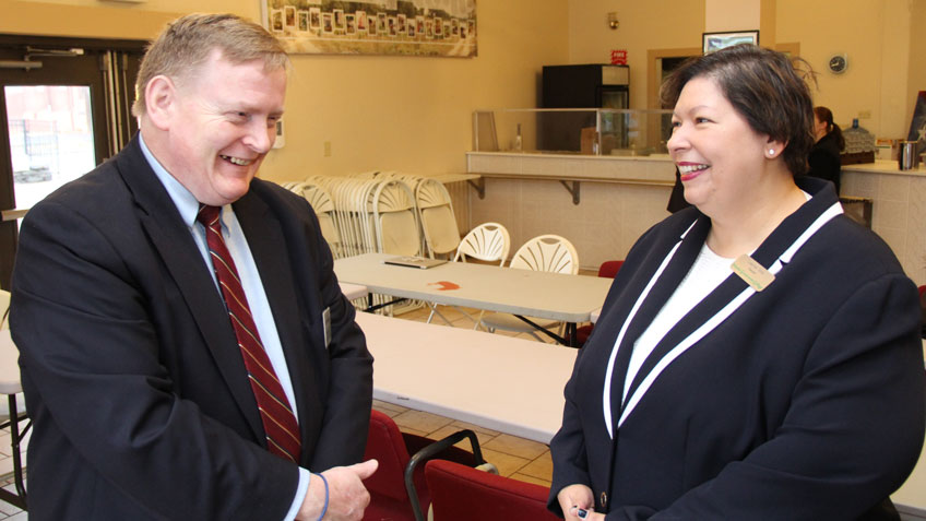 Jeffrey Hayden, HCC vice president of Business and Workforce Development, talks to HCC president Christina Royal at Nuestras Raices.