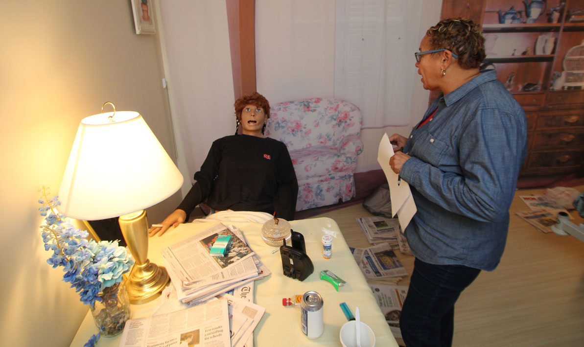 "Esther Russell of Springfield talks to ""Mrs. Johnson"" during a simulated home visit."