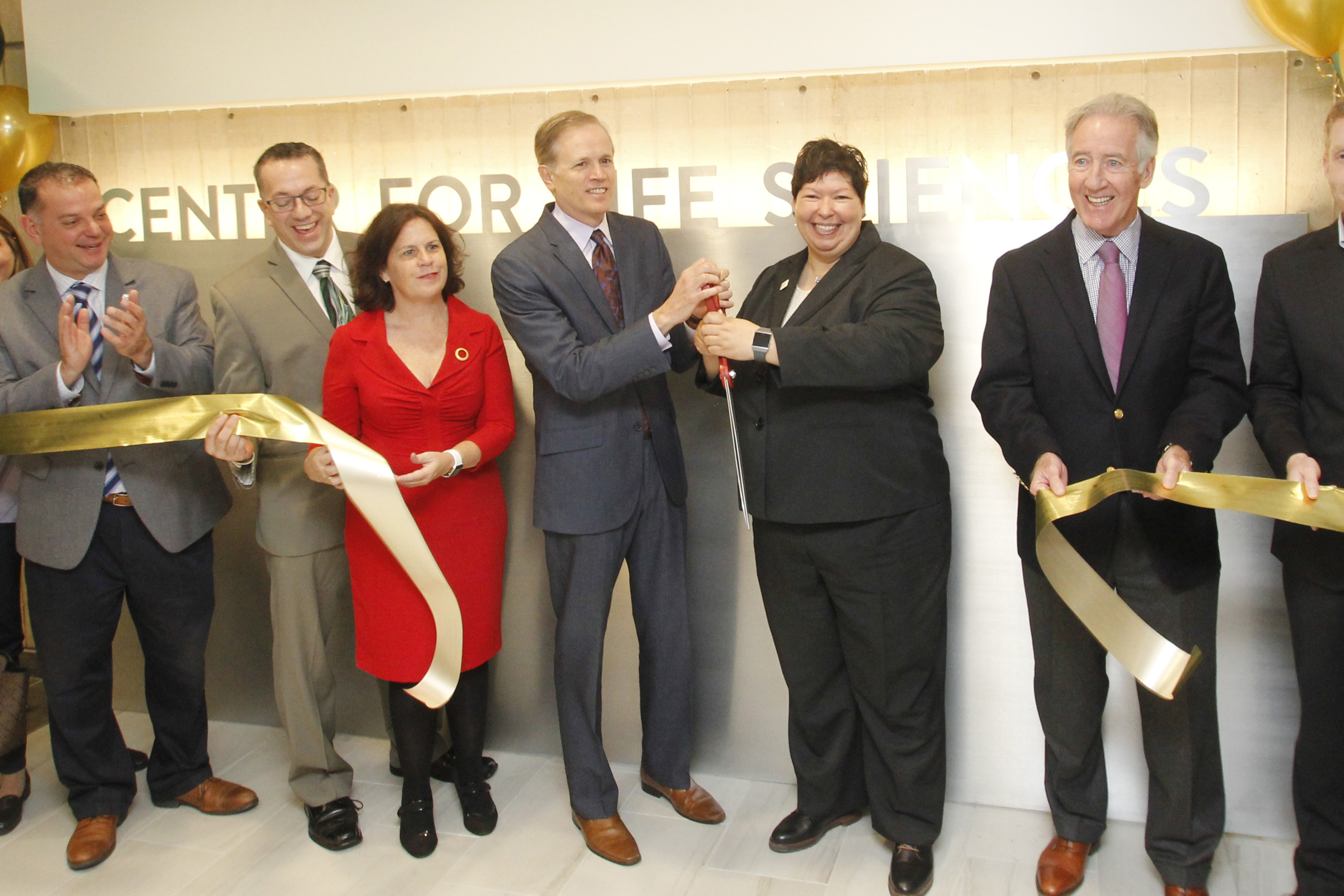 A photo of HCC president christina royal cutting the ribbon for HCC's new Center for Life Sciences
