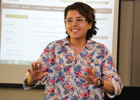 Karianne Santiago smiling in front of a class of students
