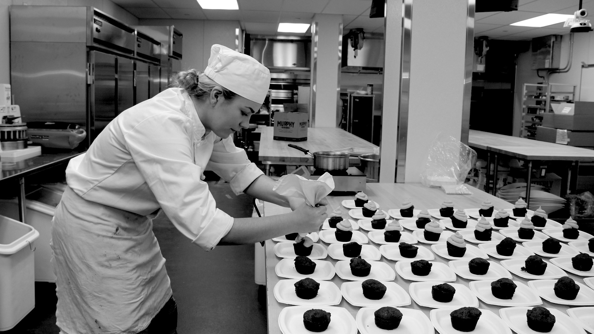 A culinary arts student frosts cupcakes at the new HCC MGM Culinary Arts Institute