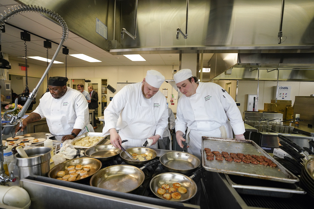 Culinary arts students cooking in the CAI kitchen
