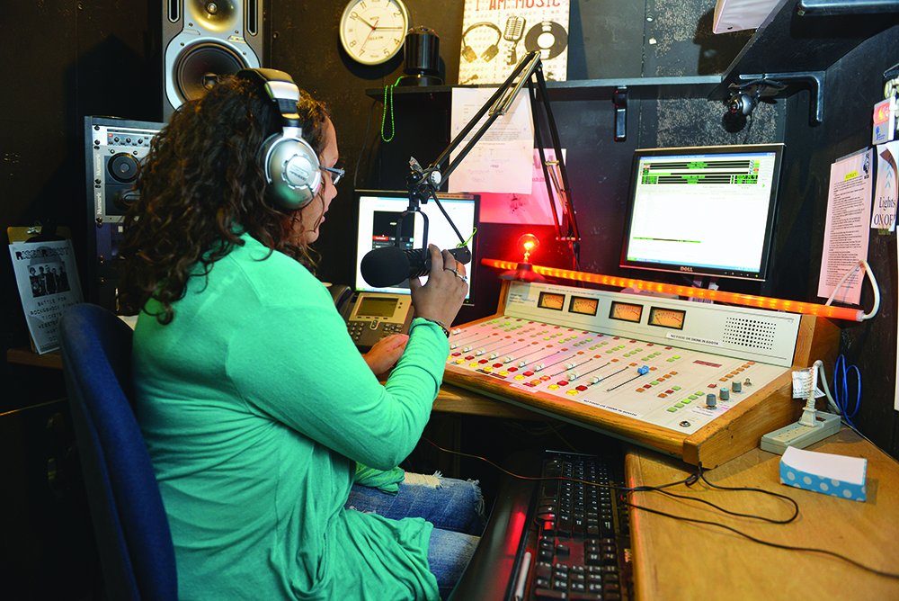 A student broadcasting in the HCC radio station