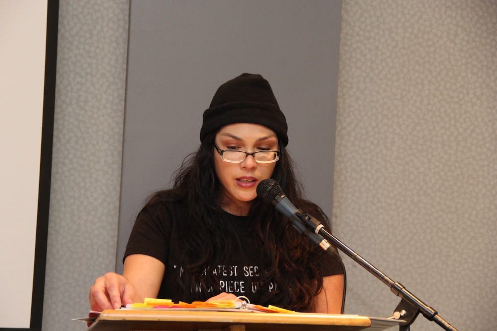 A female student reads into a microphone