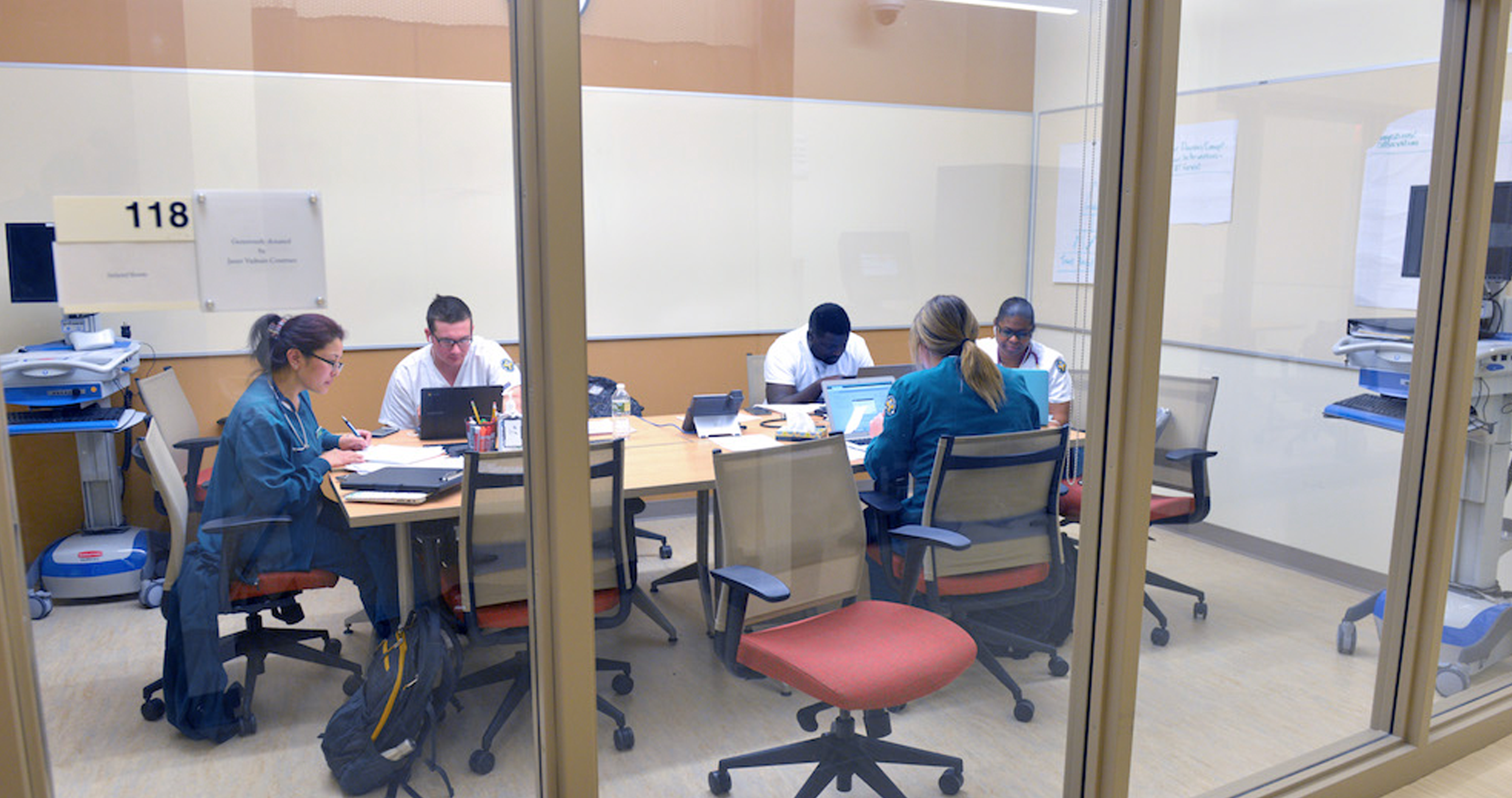 Healthcare students study together in a conference room
