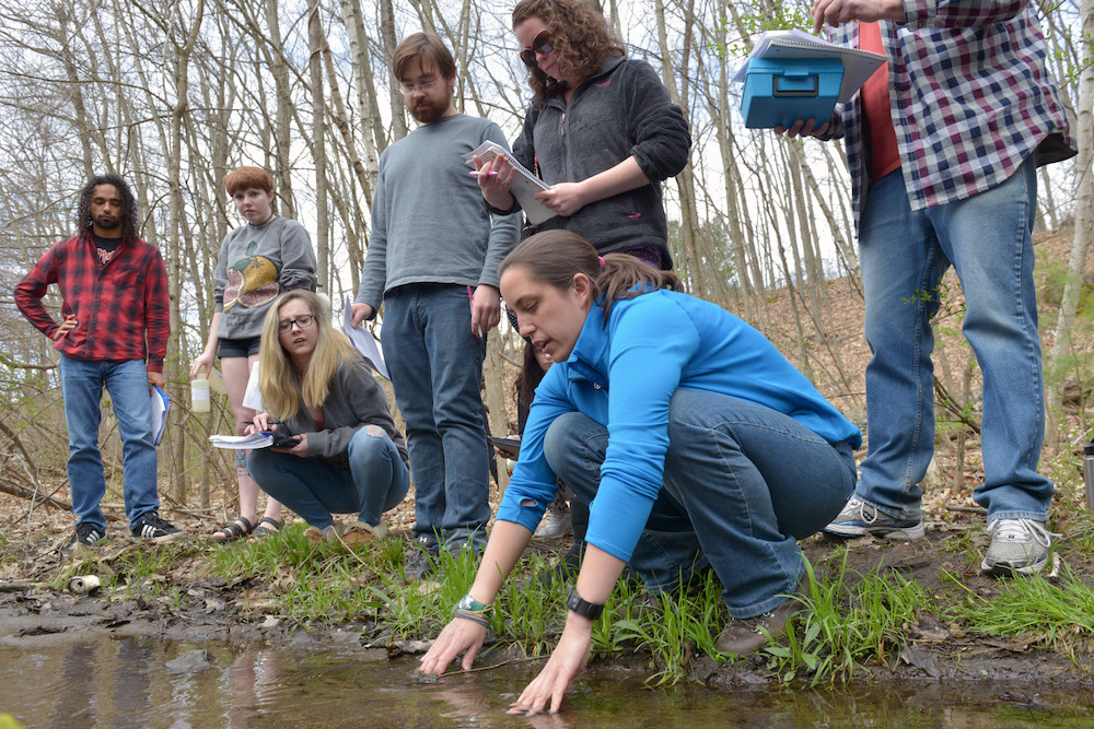 A biology class tests pond water on the HCC campus