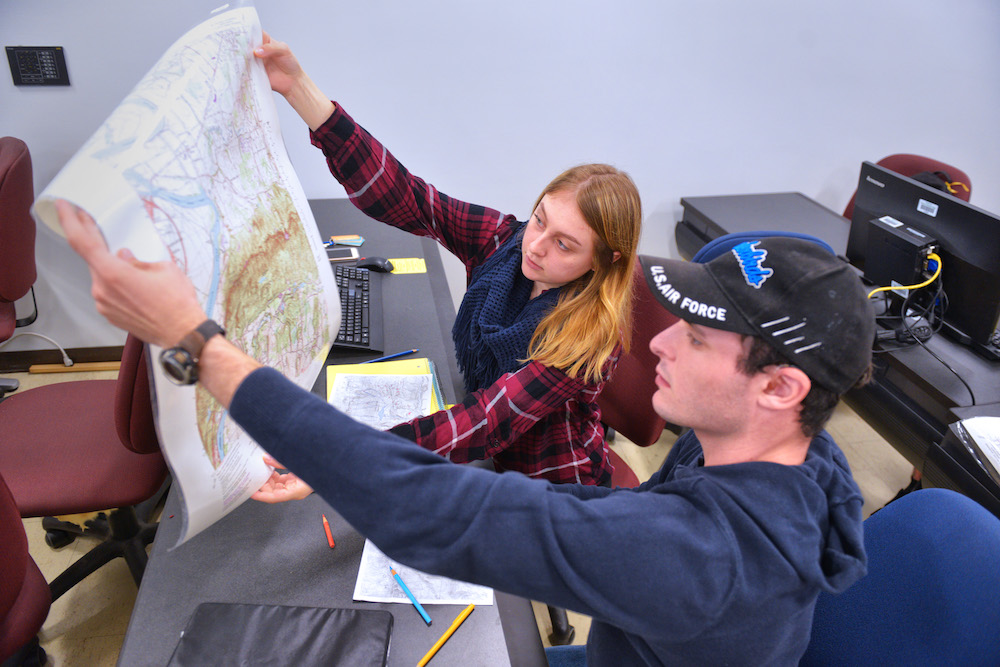 Two students examine a map