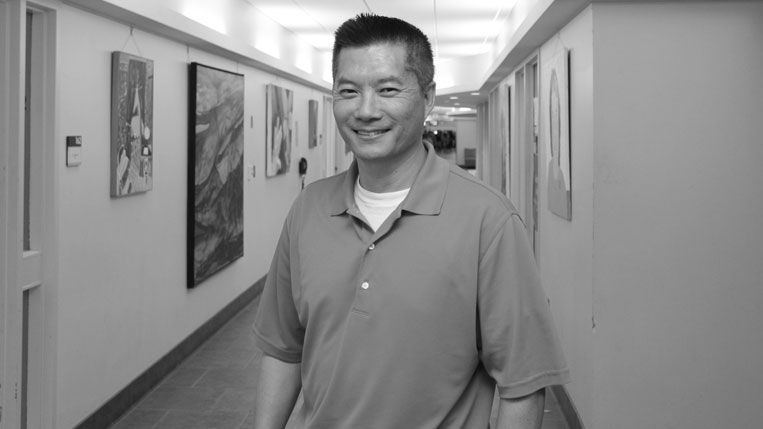 A black-and-white photo of HCC student Thomas Kim