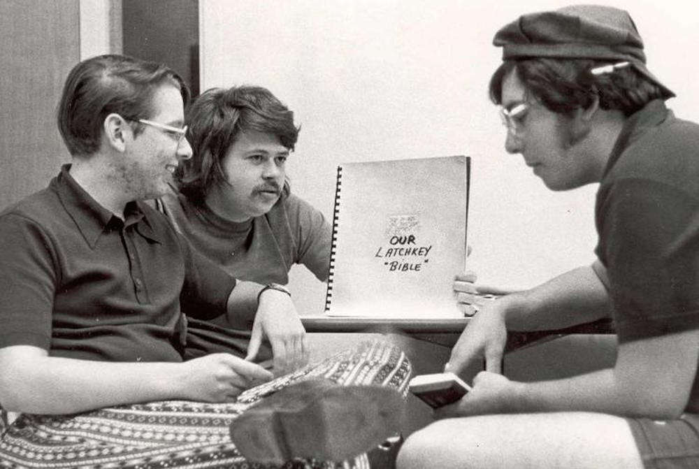 Three students work on the 1975 yearbook