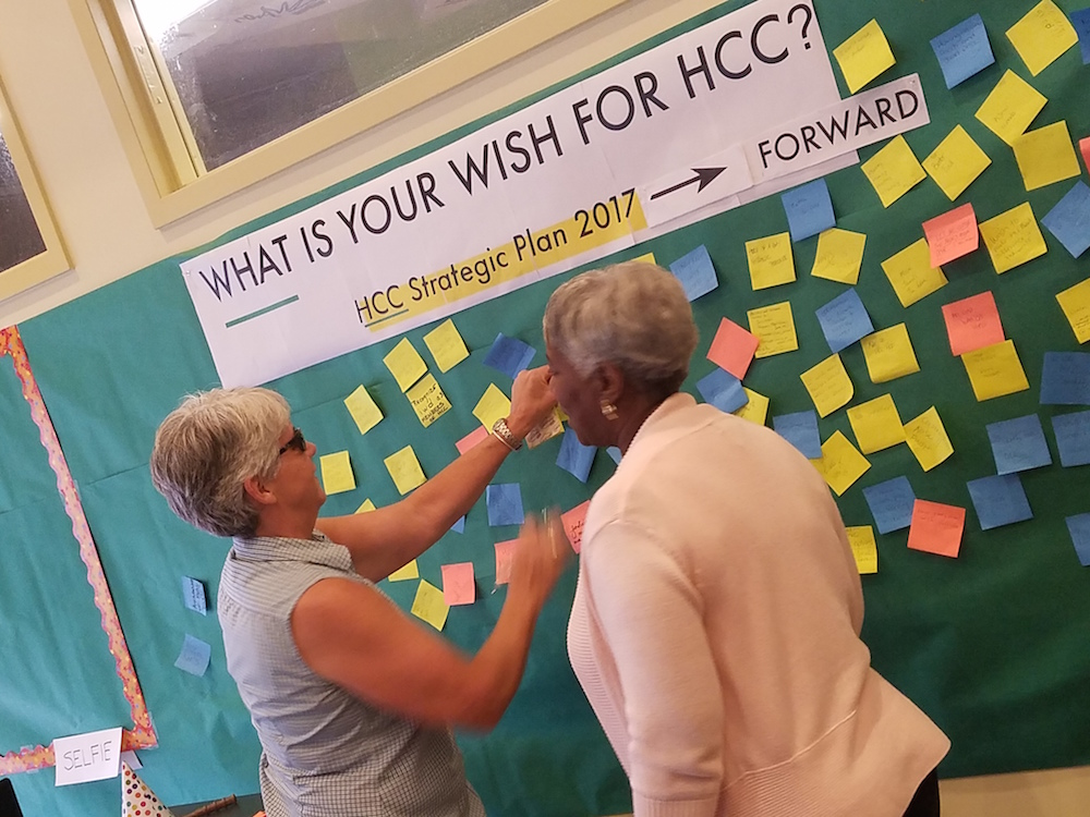 HCC community members leave ideas on post-its