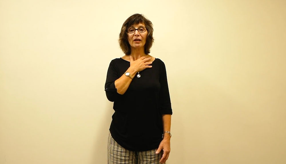 Mimsy O'Connor demonstrates the three-four-five breath, holding one hand on her throat