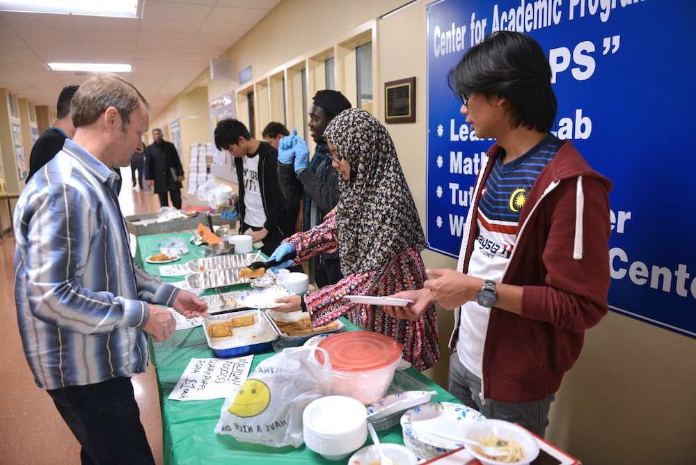 The International Club serving food